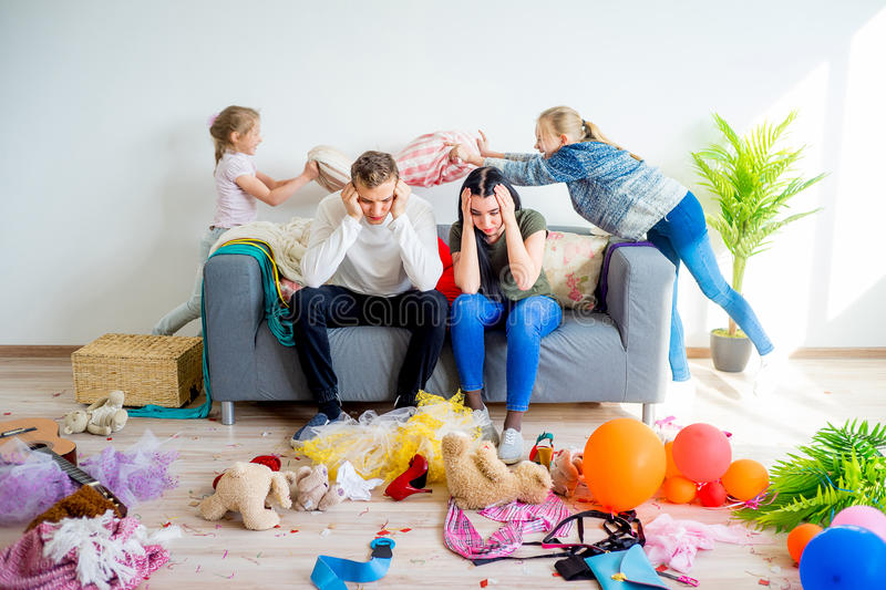 Kids romping at home. Creating a mess stock photos