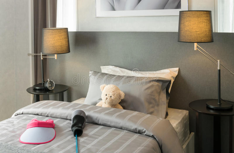 Kids room with doll bear and pillows on bed stock photography