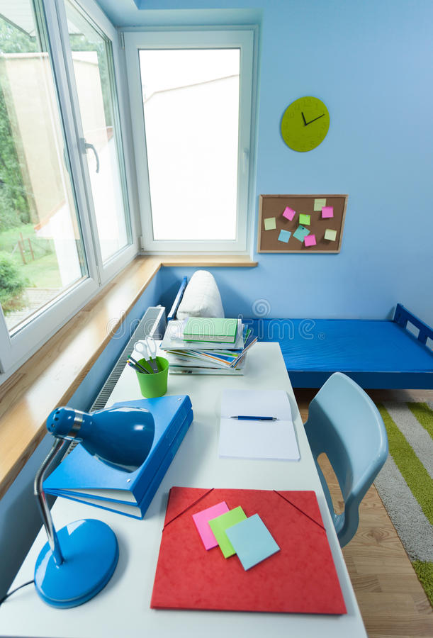 Kids room with white desk stock photography