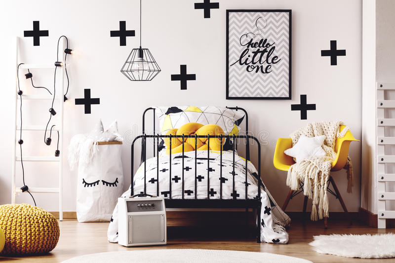 Kids room with yellow furniture royalty free stock photo