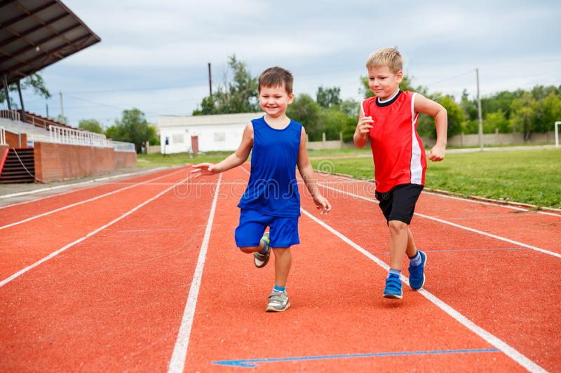 Kids running around at the sports stadium. Outdoors stock image