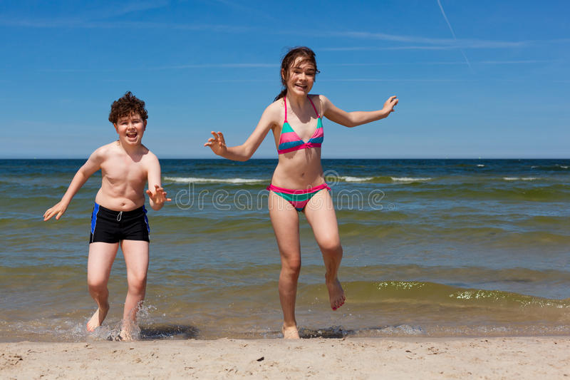 Download Kids running on beach stock photo. Image of bathing, leaping - 16190136