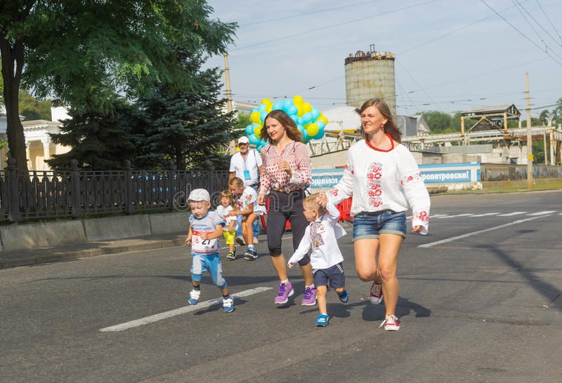 Kids running with moms stock images
