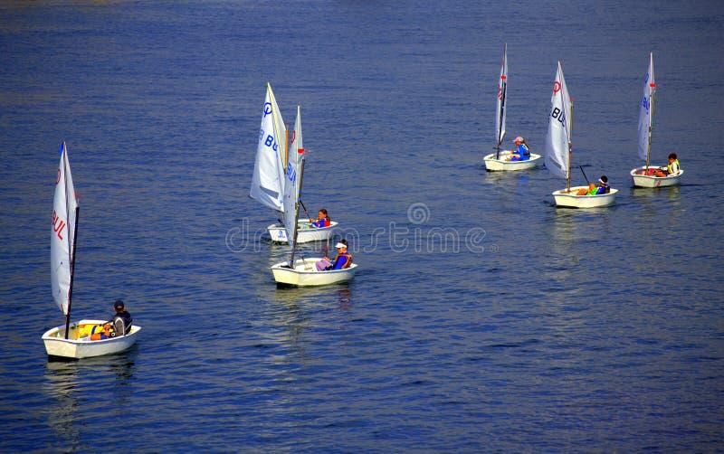 Kids sailing boats royalty free stock photo