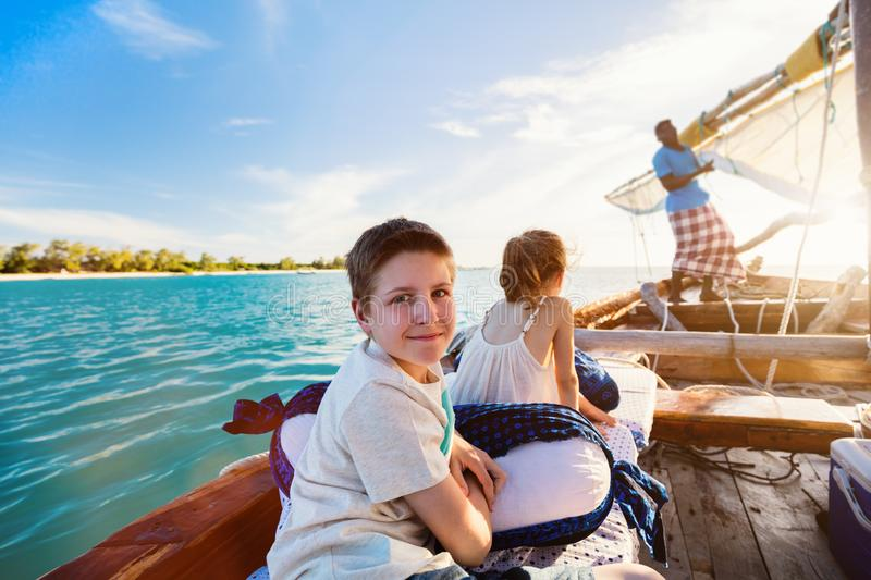 Kids sailing in dhow royalty free stock photography