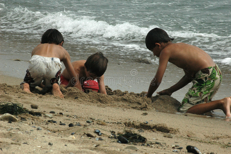 Kids in sand royalty free stock image