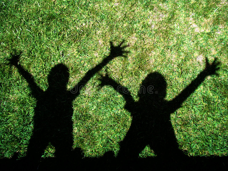 Download Kids shadows stock photo. Image of having, shadow, grass - 5677622