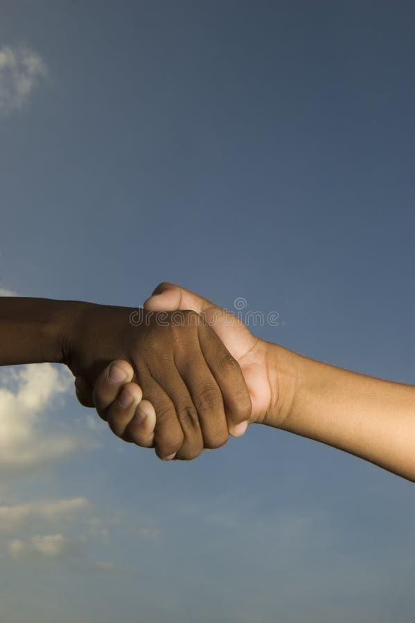 Kids shaking hands royalty free stock photos