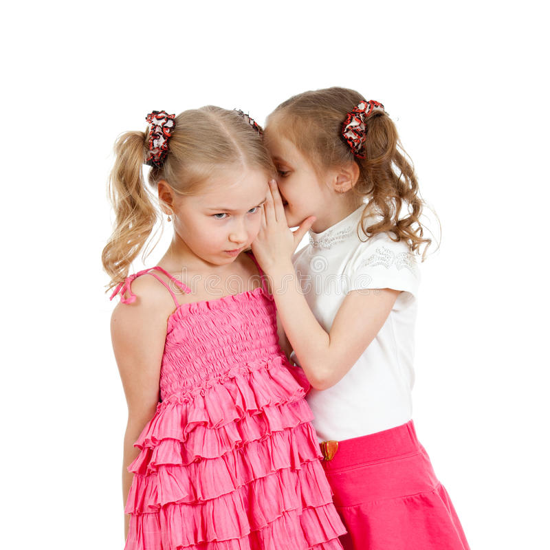 Kids sharing a secret isolated royalty free stock photos