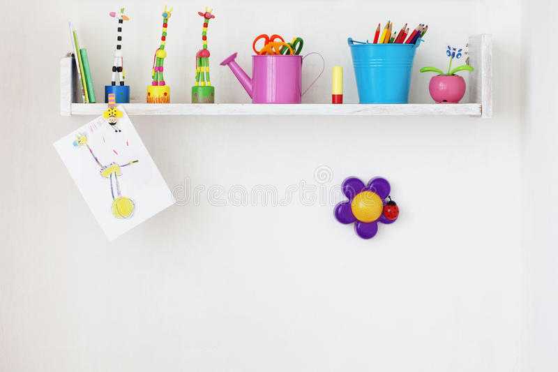 Kids shelf. On white wall with toys on it stock photo