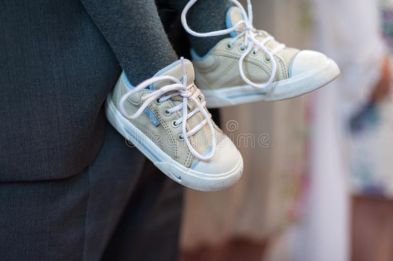 Kids Shoes and Man with Gray Suit in Background stock photos