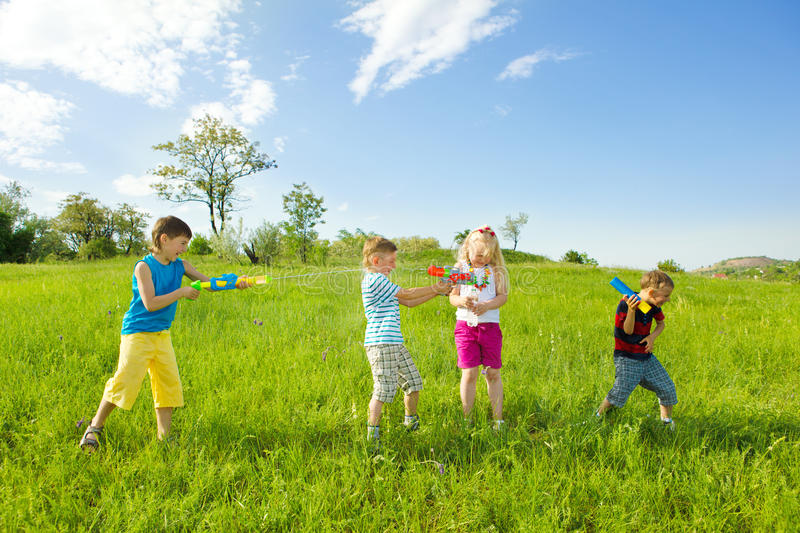 Kids Shooting Water Stock Image
