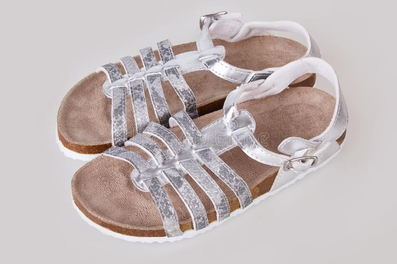 Kids silver sandals isolated on white background stock images