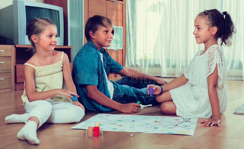 Kids sitting on floor with game stock photo
