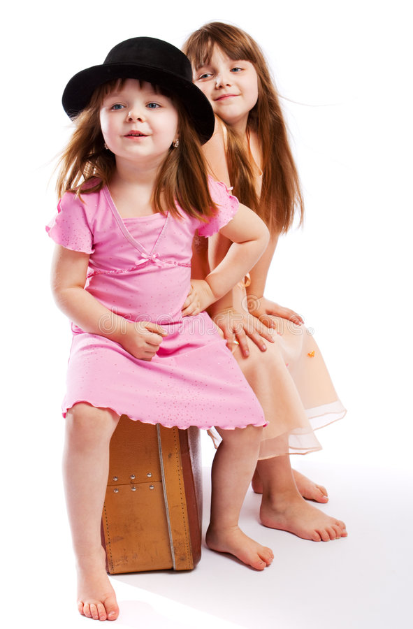 Kids sitting on suitcase royalty free stock photography