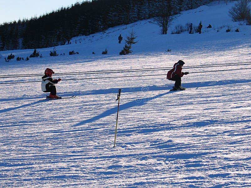 Kids on a ski lift stock photos