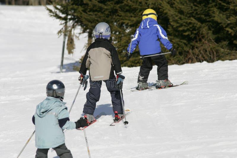 Kids skiing stock photo