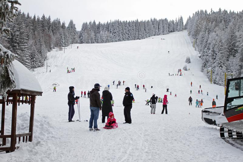 Kids skiing on a ski slope for children in winter resort in mountain of Vitosha, Bulgaria – jan 23,2018. Skiing, ski sport royalty free stock photography