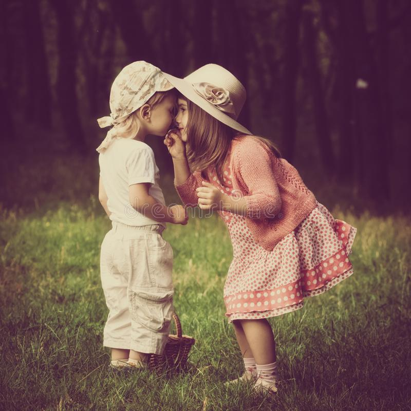 Free Kids Smelling Flowers Stock Images - 118710964