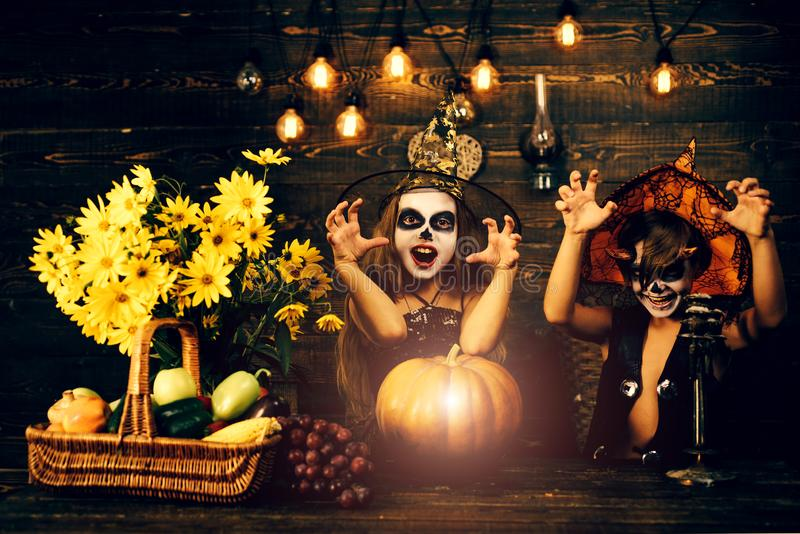 Kids smiling on a Halloween party. Funny kids dressed witch costume. Trick-or-treating. Cute children in scary costumes stock photo