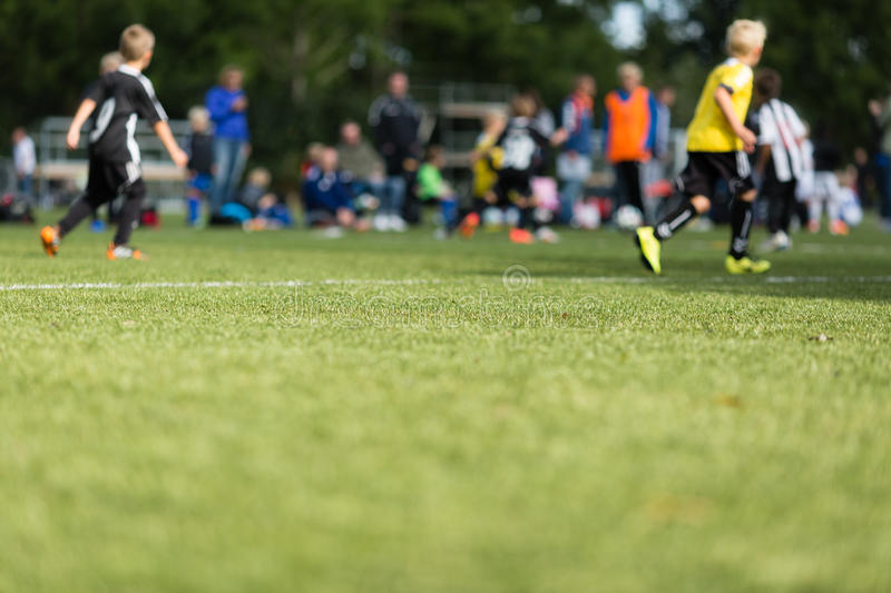 Kids soccer blur. Picture of kids soccer training match with shallow depth of field stock photography
