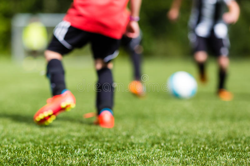 Kids soccer blur. Picture of kids soccer training match with shallow depth of field. Focus on foreground royalty free stock photos