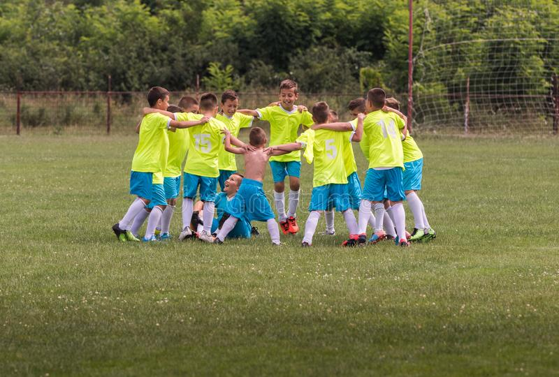 Kids soccer football - children players celebrating after victo royalty free stock photos