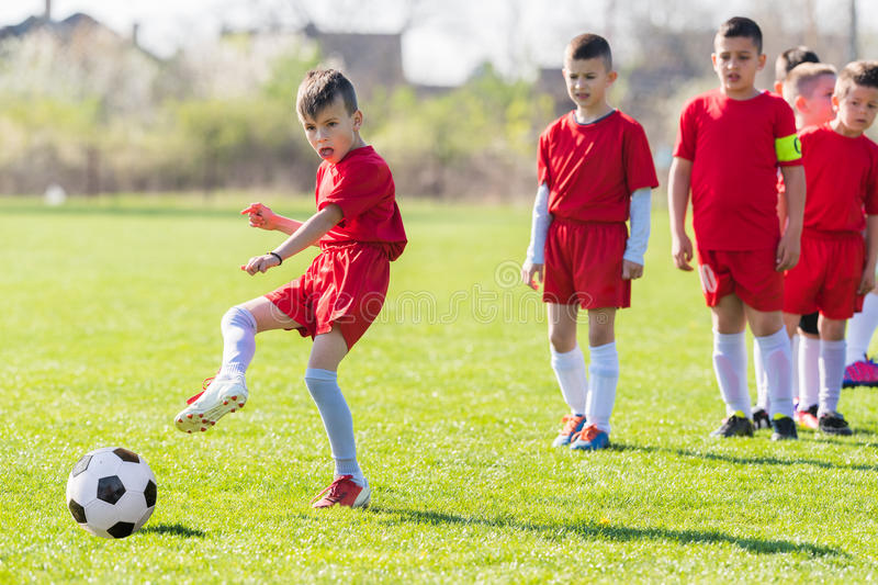Kids soccer football - children players exercising before match stock images