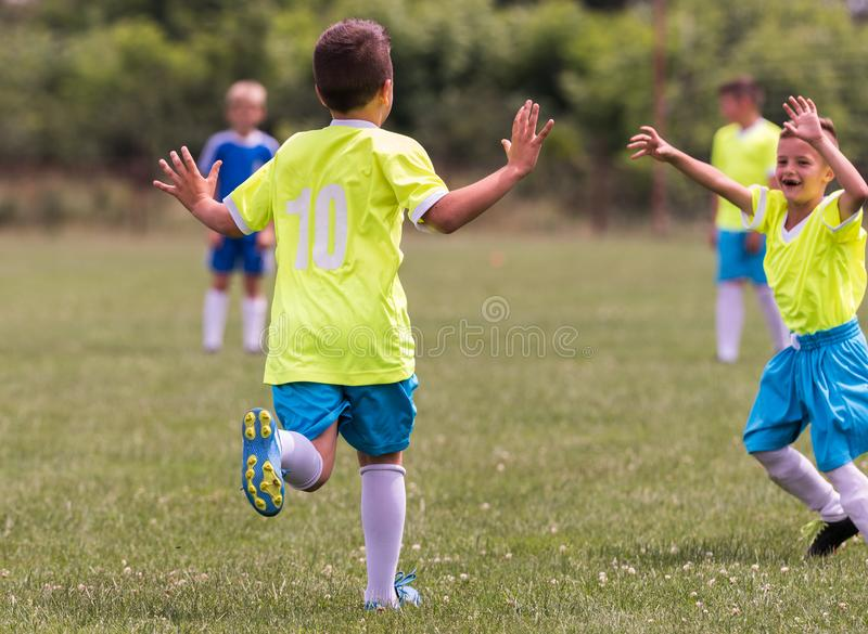 Kids soccer football - children players celebrating after victo stock photo