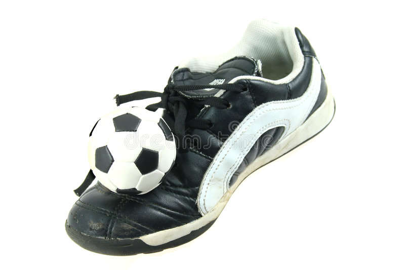 Kids soccer footwear and ball stock photos