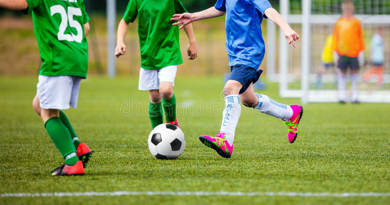 Kids soccer game. European football league for youth teams. Kids soccer game. European football league for youth primary school teams. Soccer tournament for royalty free stock images