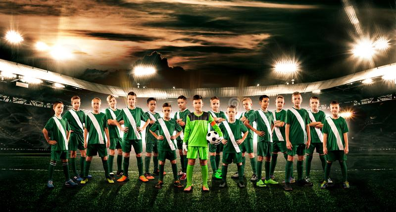 Soccer team. Kids - future champions. Boys in football sportswear on stadium with ball. Sport concept. royalty free stock photo