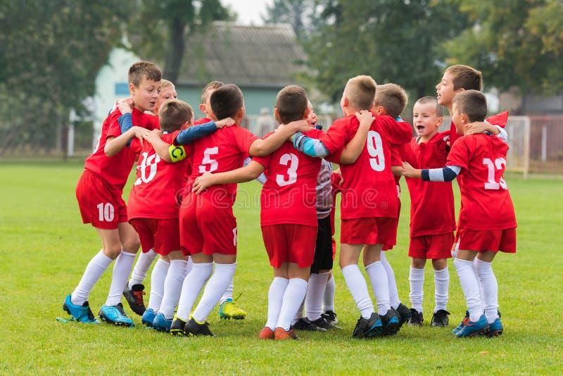 Kids soccer team in huddle stock photos
