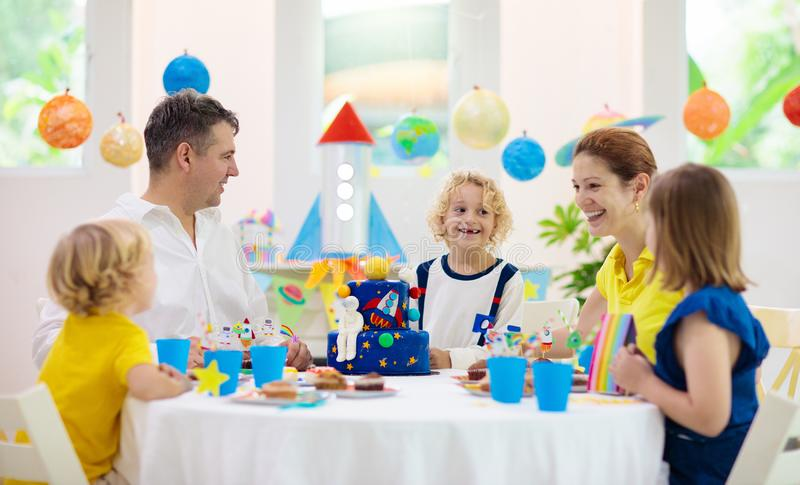 Kids space theme birthday party with cake royalty free stock photos