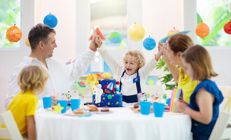 Kids space theme birthday party with cake stock photography