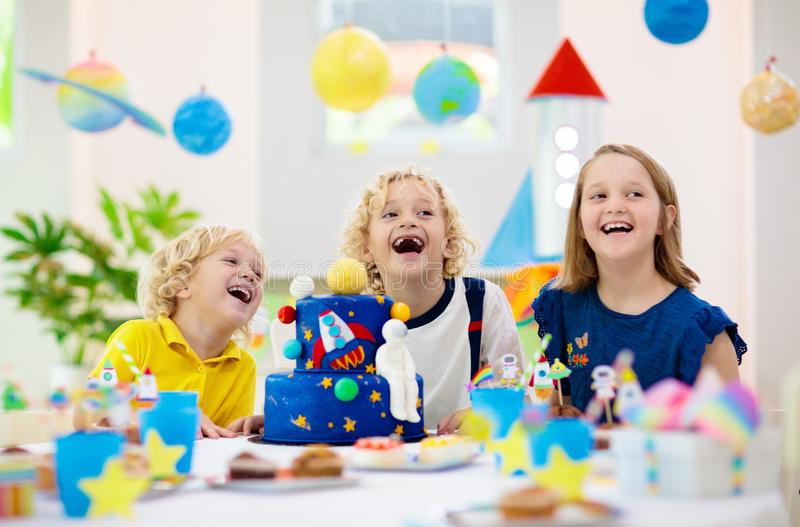 Kids space theme birthday party with cake stock image