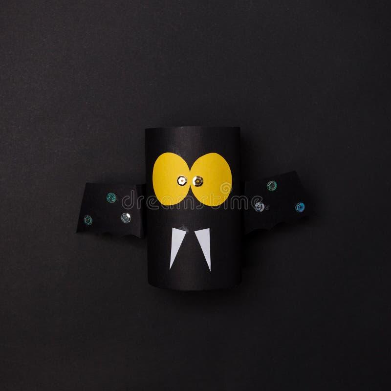 Kids spooky art, halloween celebration, paper bat on black background. stock image