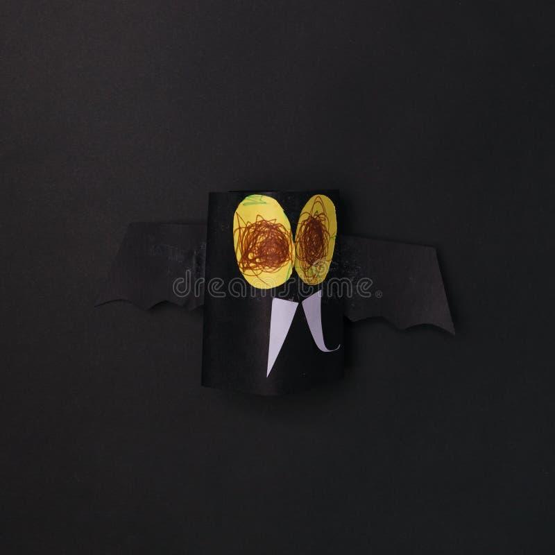 Kids spooky art, halloween celebration, paper bat on black background. royalty free stock photo