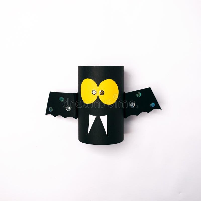 Kids spooky art, halloween celebration, paper bat on white background. Kids spooky art, halloween celebration, paper bat on white background stock photography