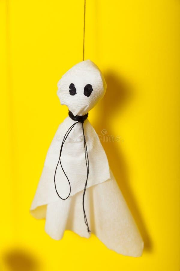 Kids spooky art, halloween celebration, paper ghosts background.  stock photo