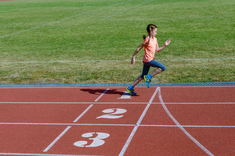 Kids sport, child running on stadium track, training and fitness. Concept royalty free stock photos