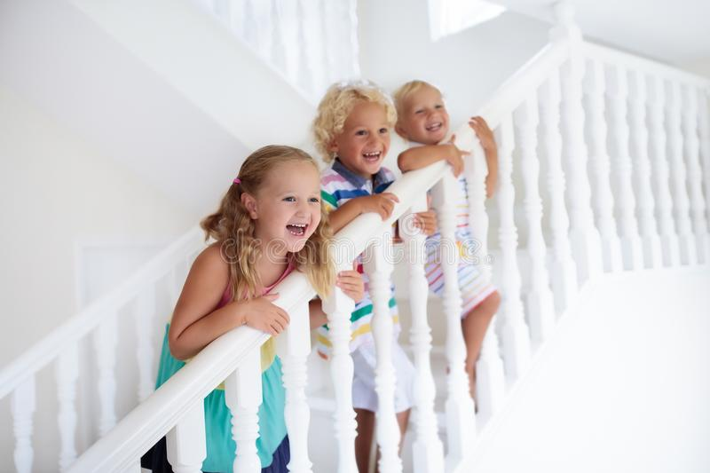 Kids on stairs. Child moving into new home. stock photo