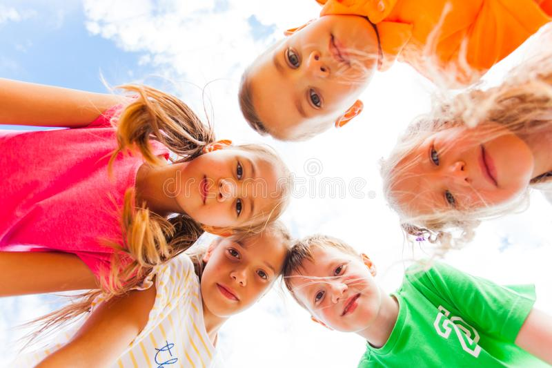 Kids standing leaning looking at the camera stock photos
