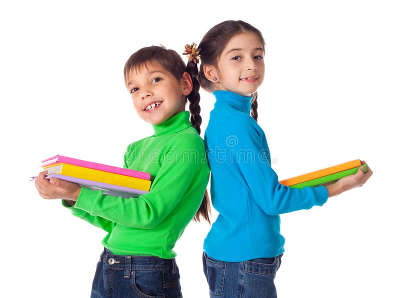 Download Kids Standing With Stack Of Books Stock Photo - Image: 27792012