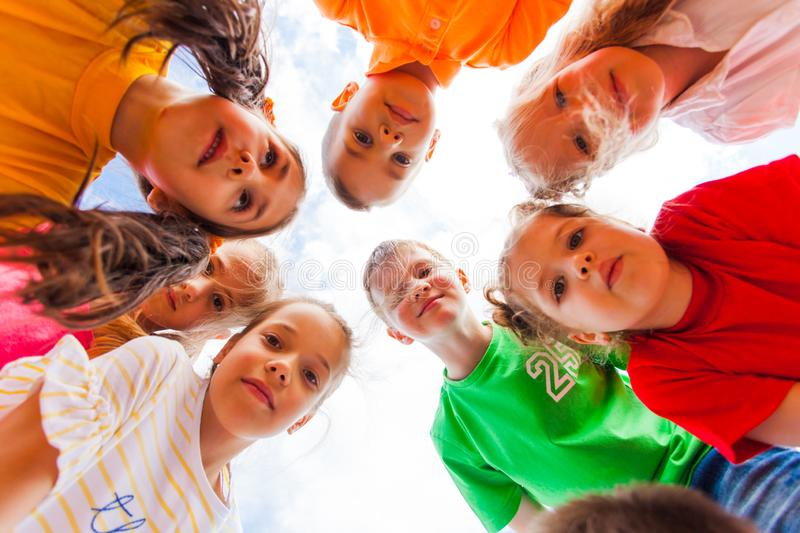 Kids standing together in circle looking at the camera royalty free stock photo