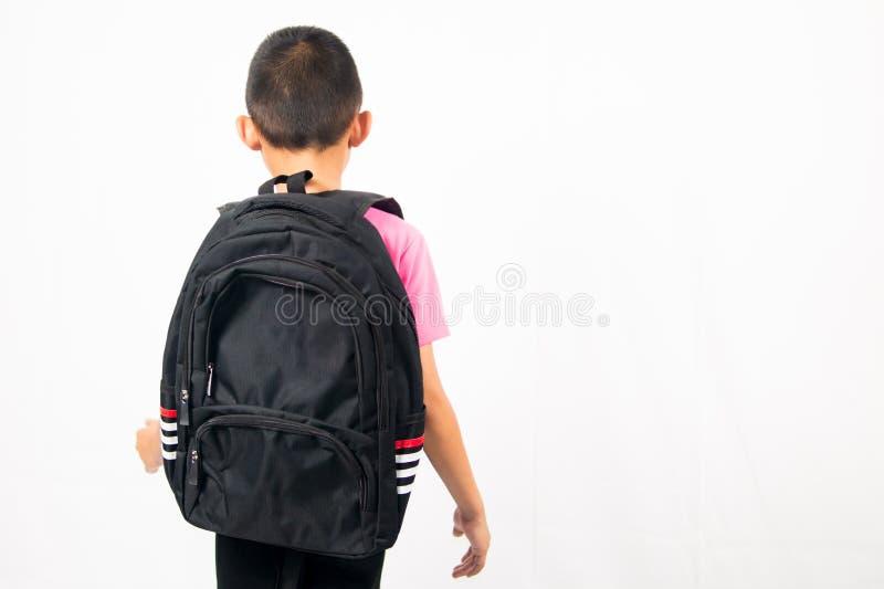Kids student holding backpack on white background stock image