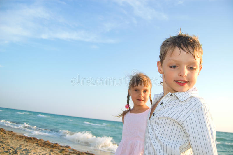 Kids at the summer beach royalty free stock photography