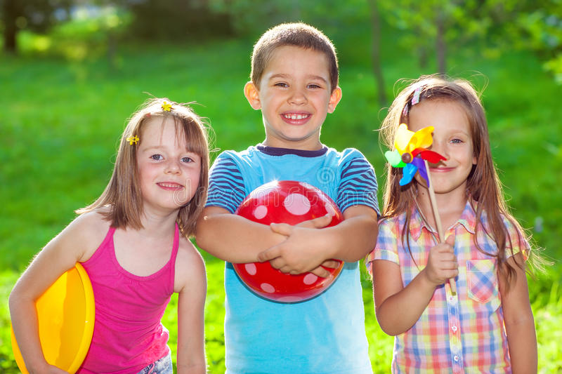 Kids in a summer park. Three smiling kids in a summer park stock photography