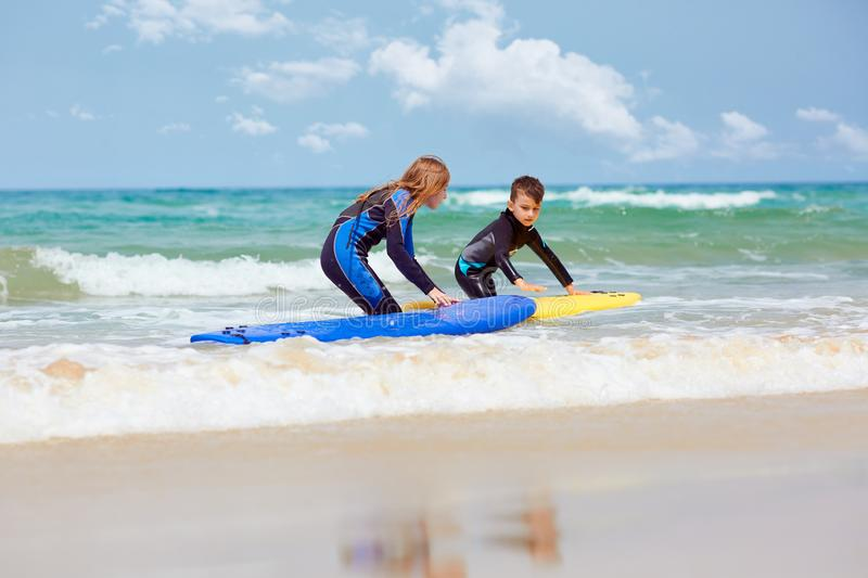 Kids with surfboards near sea royalty free stock photo