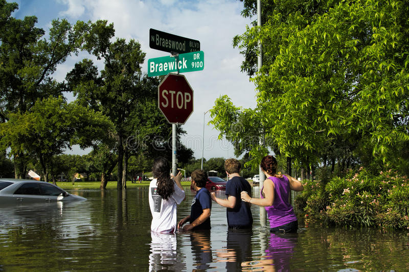 Kids Survey Flood Damage. Brays Bayou overflowed during recent Houston, Texas floods. Many residents and auto drivers were caught by surprise and forced to stock photos